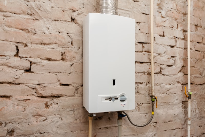 gas boiler with brick wall behind it